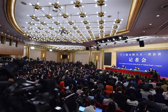 "Chinese Foreign Minister Wang Yi takes questions on China's foreign policies and foreign relations at a press conference on the sidelines of the first session of the 13th National People's Congress in Beijing, capital of China, March 8, 2018. China on Thursday gave outsiders an inside look at how the country intends to tackle diplomacy as its global influence grows. Taking questions at an annual press event, Foreign Minister Wang Yi made a rough sketch of ""major-country diplomacy with Chinese characteristics,"" which embodies championing peace, being non-threatening, standing up for the small and weak, and sharing development opportunities. Major-country diplomacy rose to prominence under President Xi Jinping's leadership. The concept involves building a new type of international relations and a community with a shared future for humanity to truly benefit the world. (Xinhua/Li Xin)"