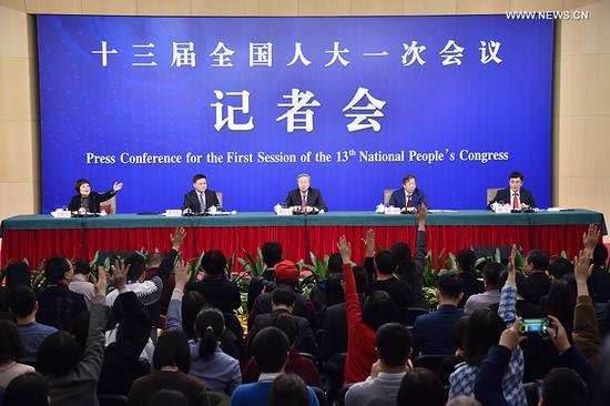 Zhou Xiaochuan (C), governor of the People's Bank of China (PBOC), Yi Gang (R), deputy governor of the PBOC and Pan Gongsheng, deputy governor of the PBOC and head of the State Administration of Foreign Exchange, attend a press conference on financial reform and development on the sidelines of the first session of the 13th National People's Congress in Beijing, capital of China, March 9, 2018. (Xinhua/LiXin)