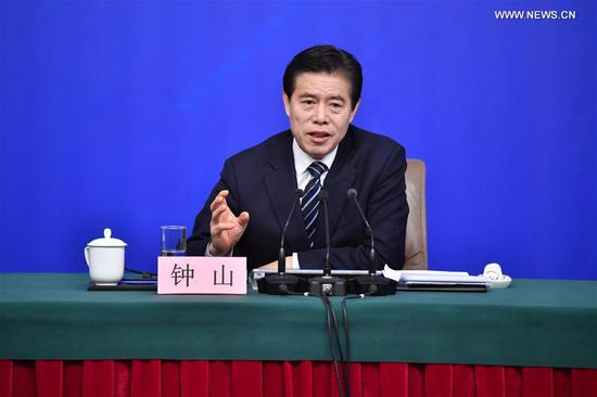 Chinese Minister of Commerce Zhong Shan answers questions at a press conference on opening up on all fronts and promoting high quality development of commercial business on the sidelines of the first session of the 13th National People's Congress in Beijing, capital of China, March 11, 2018. (Xinhua/Li Xin)