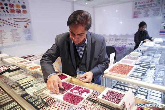 A sales person works at his booth at the JA New York Spring Show in New York, the United States, March 12, 2018. The JA New York Spring Show which lasts from March 11 to March 13 attracts about 400 exhibitors and retailers around the world this year. The JA New York jewelry show is a leading international jewelry event and is held three times a year in New York City. (Xinhua/Wang Ying)