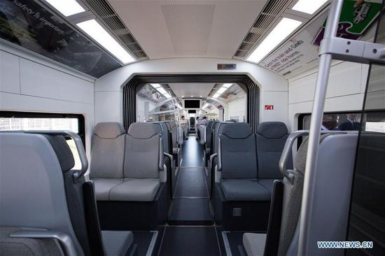 Photo taken on March 13, 2018 shows a view of the inside of the new KLIA Ekspres train at the Kuala Lumpur International Airport in Sepang, Malaysia. China's CRRC Changchun Railway Vehicles Co. Ltd (CRRC Changchun) and Malaysia's Express Rail Link (ERL) unveiled the new train that will be used for the Kuala Lumpur International Airport rail link service on Tuesday, concluding a deal signed in 2014 in which ERL agreed to buy six trains from CRRC Changchun. (Xinhua/Zhu Wei)