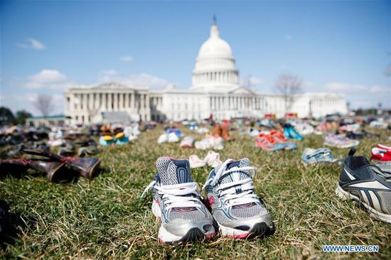Shoes representing the children killed in school shootings since Sandy Hook Elementary School shooting in 2012 are seen on the lawn in front of the Capitol in Washington D.C., the United States, on March 13, 2018. An activist group on Tuesday placed 7,000 pairs of shoes on the lawn in front of U.S. Congress, in protest against lawmakers' inaction in face of frequent school shootings in the country. (Xinhua/Ting Shen)