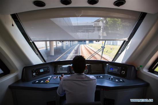 A driver drives the new KLIA Ekspres train at the Kuala Lumpur International Airport in Sepang, Malaysia, on March 13, 2018. China's CRRC Changchun Railway Vehicles Co. Ltd (CRRC Changchun) and Malaysia's Express Rail Link (ERL) unveiled the new train that will be used for the Kuala Lumpur International Airport rail link service on Tuesday, concluding a deal signed in 2014 in which ERL agreed to buy six trains from CRRC Changchun. (Xinhua/Zhu Wei)