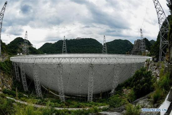 File photo taken on Aug. 9, 2017, shows the Five-hundred-meter Aperture Spherical Radio Telescope (FAST) in Pingtang County, southwest China's Guizhou Province. China's FAST, the world's largest single-dish radio telescope, has discovered 11 new pulsars so far, the National Astronomical Observatories of China (NAOC) said Tuesday. (Xinhua/Ou Dongqu)