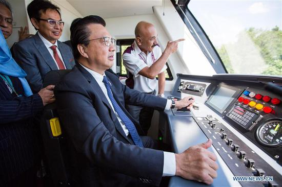 Malaysian Transport Minister Liow Tiong Lai drives the new KLIA Ekspres train near the Kuala Lumpur International Airport in Sepang, Malaysia, on March 13, 2018. China's CRRC Changchun Railway Vehicles Co. Ltd (CRRC Changchun) and Malaysia's Express Rail Link (ERL) unveiled the new train that will be used for the Kuala Lumpur International Airport rail link service on Tuesday, concluding a deal signed in 2014 in which ERL agreed to buy six trains from CRRC Changchun. (Xinhua/Zhu Wei)