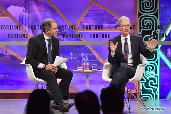 Tim Cook (R), chief executive officer of Apple, speaks at a plenary session during the 2017 Fortune Global Forum in Guangzhou, south China's Guangdong Province, Dec. 6, 2017. (Xinhua/Sun Ruibo)