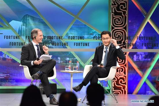Pony Ma (R), co-founder, chairman of the Board and CEO of Tencent, speaks at a plenary session during the 2017 Fortune Global Forum in Guangzhou, south China's Guangdong Province, Dec. 6, 2017. (Xinhua/Sun Ruibo)