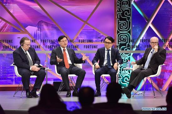 Yang Yuanqing (2nd L), chairman and CEO of Lenovo Group Ltd., speaks at a plenary session during the 2017 Fortune Global Forum in Guangzhou, south China's Guangdong Province, Dec. 6, 2017. (Xinhua/Sun Ruibo)