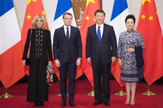 Xi met with visiting French President Emmanuel Macron