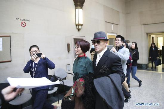 Zhou Libo (R, front) and his wife Hu Jie (C, front) arrive at Nassau County Court in Nassau County, New York, Feb. 1, 2018. Chinese comedian Zhou Libo appeared in a session with the judge and prosecutor here on Thursday. Zhou is charged with illegal possession of a handgun, possession of a controlled substance identified as crystal methamphetamine and driving while using a cellphone. (Xinhua/Wang Ying)
