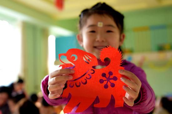 Children learn paper-cutting to greet upcoming Chinese lunar New Year in N China