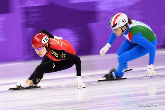 China's Zhou Yang (L) competes during the women's 3000m relay heat of short track speed skating event of 2018 PyeongChang Winter Olympic Games at Gangneung Ice Arena, South Korea, Feb. 10, 2018. China advanced to the final in a time of 4:05.315 and set a new Olympic record of the event. (Xinhua/Ju Huanzong)