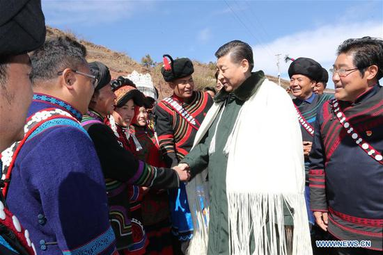 Chinese President Xi Jinping, also general secretary of the Communist Party of China Central Committee, visits the homes of impoverished villagers of the Yi ethnic group who live deep in the Daliang Mountains of Zhaojue County, Sichuan Province in southwest China, Feb. 11, 2018. Xi asked the villagers about their lives and discussed poverty alleviation with local officials and villagers on Sunday. (Xinhua/Ju Peng)