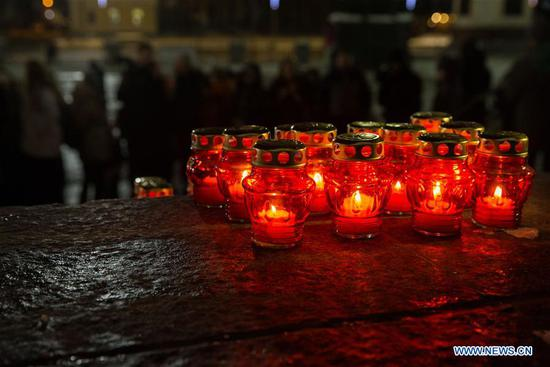 Candles are placed to mourn the victims in the AN-148 passenger jet crash near the Cathedral of Christ the Saviour in Moscow, Russia, on Feb. 12, 2018. Rescuers have presumably recovered the second flight data recorder of the AN-148 passenger jet that crashed in the Moscow region on Sunday, the Russian Emergencies Ministry said Monday. On Sunday, an Antonov-148 of Saratov Airlines bound for the city Orsk in Russia's Orenberg Region bordering Kazakhstan crashed shortly after takeoff from Moscow's Domodedovo Airport, killing all people on board, including 65 passengers and six crew members. (Xinhua/Bai Xueqi)