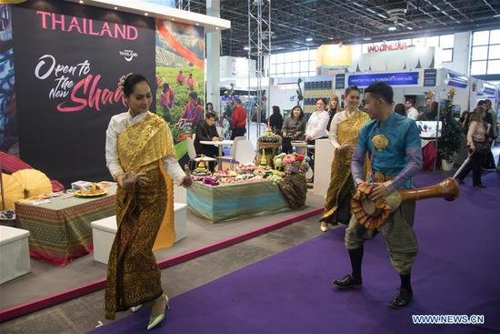 Thai dancers perform in front of the exhibition stand of Thailand at the 2018 Travel Exhibition in Budapest, Hungary, on March 1, 2018. The 2018 Travel Exhibition, with 280 exhibitors from 23 countries, started here on Thursday. (Xinhua/Attila Volgyi)