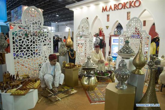 Handicraftsmen are seen at the exhibition stand of Morocco at the 2018 Travel Exhibition in Budapest, Hungary, on March 1, 2018. The 2018 Travel Exhibition, with 280 exhibitors from 23 countries, started here on Thursday. (Xinhua/Attila Volgyi)