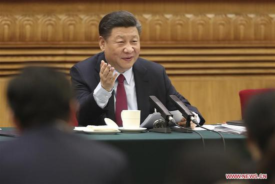 Chinese President Xi Jinping, also general secretary of the Communist Party of China (CPC) Central Committee and chairman of the Central Military Commission, joins a panel discussion with deputies from Shandong Province at the first session of the 13th National People's Congress in Beijing, capital of China, March 8, 2018. (Xinhua/Sheng Jiapeng)