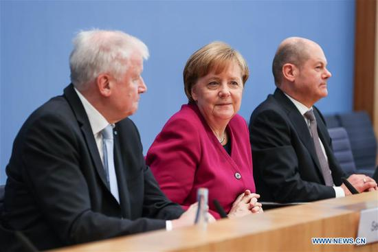 German Chancellor and Christian Democratic Union (CDU) leader Angela Merkel (C), interim German Social Democrats (SPD) leader Olaf Scholz (R) and Christian Social Union (CSU) leader Horst Seehofer attend a press conference in Berlin, capital of Germany, on March 12, 2018. The leaders of the Christian Democratic Union (CDU), Christian Social Union (CSU) and German Social Democrats (SPD) revealed the key priorities of Germany's new federal government on Monday. (Xinhua/Shan Yuqi)