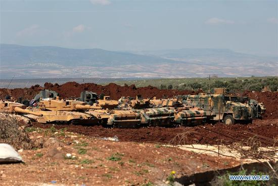 Photo taken on March 12, 2018 shows Turkish armored vehicles deployed near city center of Syria's Afrin. Turkish military and its ally the Free Syrian Army made rapid advances during its operation in Syria's Afrin region on Monday, only 1.5 km away from its city center, state-run Anadolu Agency reported. (Xinhua)