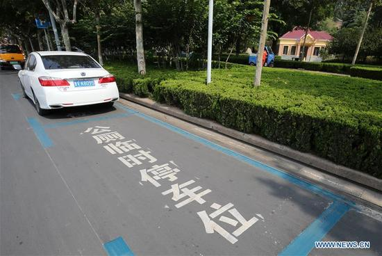 Photo taken on Sep. 15, 2017 shows a temporary parking spot reserved for public toilet in Weifang, east China's Shandong Province. The Chinese government launched its