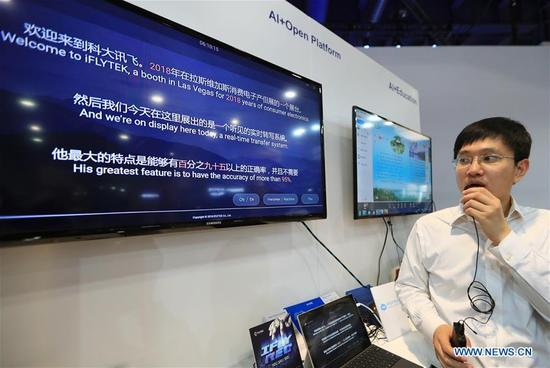 A staff member of Chinese company IFLYTEK shows a real-time translation system at Consumer Electronics Show (CES) in Las Vegas, the United States, Jan. 10, 2018. (Xinhua/Li Ying)