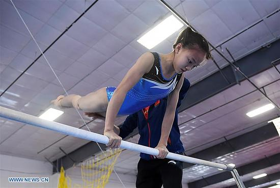 Chen Yile, a member of China's women gymnastic team, is seen during training at Chow's Gymnastics and Dance Institute in West Des Moines, Iowa, the United States, on Dec. 27, 2017. Four Chinese women gymnasts have attended a 20-day training program in Iowa since Dec. 11. (Xinhua/Yin Bogu)