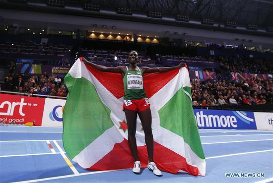Francine Niyonsaba of Burundi celebrates after winning the women's 800 metres final during the IAAF World Indoor Championships at Arena Birmingham in Birmingham, Britain on March 4, 2018. (Xinhua/Han Yan)
