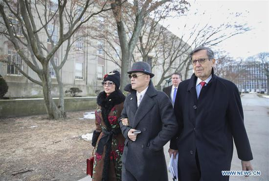 Zhou Libo (C) leaves Nassau County Court after a court session in Nassau County, New York, the United States, Feb. 1, 2018. Chinese comedian Zhou Libo appeared in a court session with the judge and prosecutor here on Thursday. Zhou is charged with illegal possession of a handgun, possession of a controlled substance identified as crystal methamphetamine and driving while using a cellphone. (Xinhua/Wang Ying)