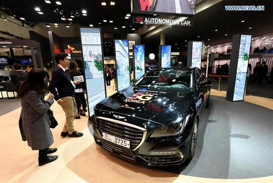 Photo taken on Feb. 26, 2018 shows the SK Telecom 5G Concept Car during the 2018 Mobile World Congress (MWC) in Barcelona, Spain. The four-day 2018 MWC opened on Monday. (Xinhua/Guo Qiuda)