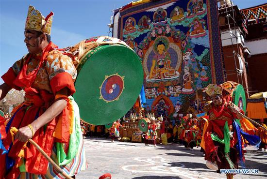 Monks perform religious dance at the Qoide Monastery in Gonggar County of Shannan Prefecture, southwest China's Tibet Autonomous Region, March 2, 2018. (Xinhua/Purbu Zhaxi)
