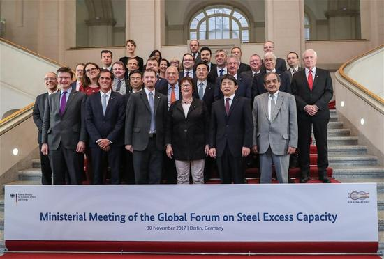 Delegates pose for a group photo after the ministerial meeting of Global Forum on Steel Excess Capacity in Berlin, Germany, on Nov. 30, 2017. China called for more global cooperation in addressing the steel overcapacity across the world at the Ministerial meeting of Global Forum on Steel Excess Capacity held here on Thursday. (Xinhua/Shan Yuqi)