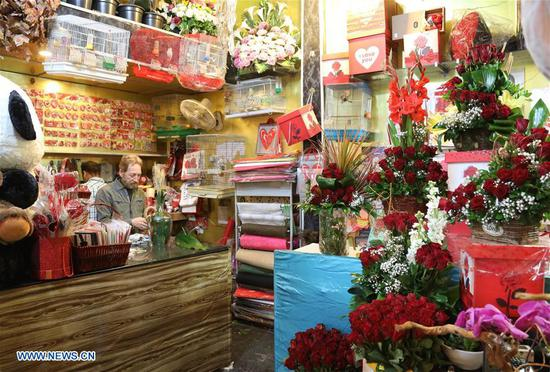 A shop is decorated with roses and gifts ahead of the Valentine's Day in Baghdad, Iraq, on Feb. 13, 2018. (Xinhua/Khalil Dawood)