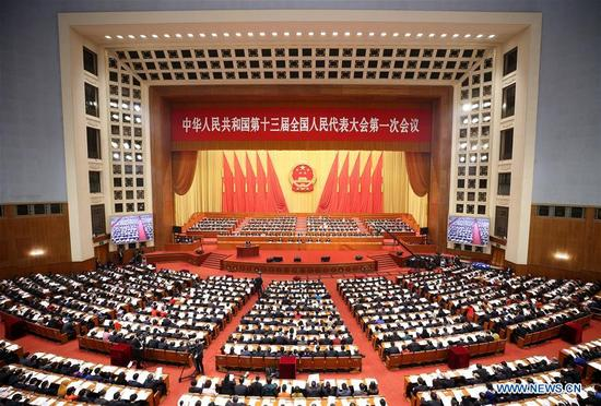 The fourth plenary meeting of the first session of the 13th National People's Congress (NPC) is held at the Great Hall of the People in Beijing, capital of China, March 13, 2018. (Xinhua/Yao Dawei)