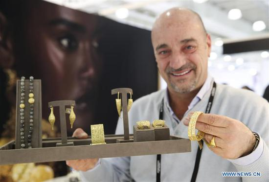 Designer Yossi Harari from Israel shows his jewelries at his booth at the JA New York Spring Show in New York, the United States, March 12, 2018. The JA New York Spring Show which lasts from March 11 to March 13 attracts about 400 exhibitors and retailers around the world this year. The JA New York jewelry show is a leading international jewelry event and is held three times a year in New York City. (Xinhua/Wang Ying)