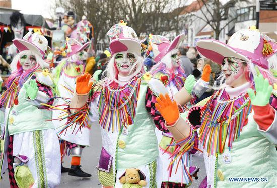 Revelers attend the 90th carnival parade in Aalst, some 30 kilometers northwest from Brussels, capital of Belgium, on Feb. 11, 2018. Thousands of revelers participated in the annual Aalst Carnival on Sunday, which was inscribed on the Representative List of the Intangible Cultural Heritage of Humanity by UNESCO in 2010. (Xinhua/Ye Pingfan)