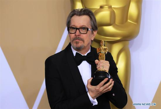 Actor Gary Oldman poses after winning the Best Actor award for
