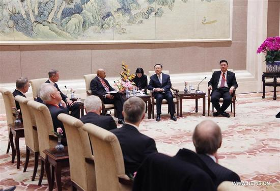 Chinese State Councilor Yang Jiechi (2nd R, rear), also member of the Political Bureau of the Communist Party of China (CPC) Central Committee, meets with Democrat and Republican representatives from the United States, in Beijing, capital of China, Dec. 3, 2017. The U.S. delegates are attending the CPC in Dialogue with World Political Parties High-Level Meeting in Beijing. (Xinhua/Liu Weibing)