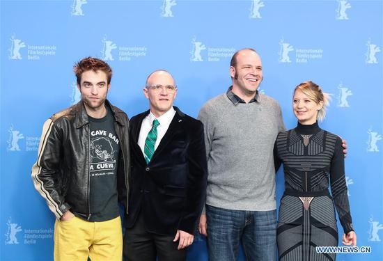 Directors David Zellner (2nd L) and Nathan Zellner (2nd R) pose for photos with actor Robert Pattinson (1st L) and actress Mia Wasikowska during the photocall of film