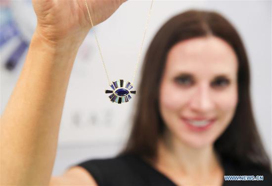 Jewelry Designer Theresa Kaz shows her design at her booth at the JA New York Spring Show in New York, the United States, March 12, 2018. The JA New York Spring Show which lasts from March 11 to March 13 attracts about 400 exhibitors and retailers around the world this year. The JA New York jewelry show is a leading international jewelry event and is held three times a year in New York City. (Xinhua/Wang Ying)