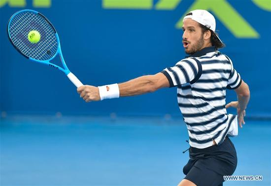 Feliciano Lopez of Spain hits a return during the first round match against Guillermo Garcia-Lopez of Spain at the ATP Qatar Open in Doha, Qatar, on Jan. 2, 2018. Feliciano Lopez won 2-1. (Xinhua/Nikku)