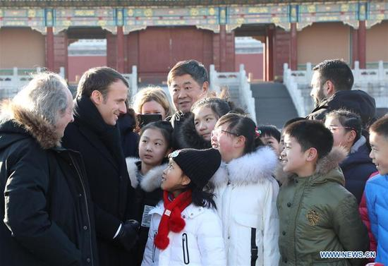 French President Emmanuel Macron and his wife Brigitte Macron visit the Palace Museum, or the Forbidden City, in Beijing, capital of China, Jan. 9, 2018. The French president is paying a state visit to China from Monday to Wednesday. (Xinhua/Zhou Gaoliang)