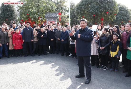 Chinese President Xi Jinping, also general secretary of the Communist Party of China Central Committee and chairman of the Central Military Commission, extends the Spring Festival greetings in Zhanqi Village of Pidu District in Chengdu, southwest China's Sichuan Province, Feb. 12, 2018. Xi made an inspection tour in Sichuan and extended greetings ahead of the Spring Festival, which falls on Feb. 16 this year. (Xinhua/Ju Peng)