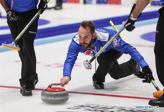 Italy's Joel Retornaz casts stone during an Olympic Qualification match of curling for 2018 Winter Olympics in Pyeongchang between men's teams from China and Italy, in Pilsen, the Czech Republic, on Dec. 6, 2017. China won 10-5. (Xinhua/Shan Yuqi)