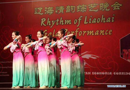 Chinese artists perform during the Rhythm of Liaohai Gala Performance in Islamabad, capital of Pakistan on Dec. 7, 2017. (Xinhua/Ahmad Kamal)