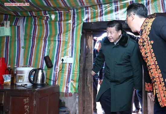 Chinese President Xi Jinping, also general secretary of the Communist Party of China Central Committee and chairman of the Central Military Commission, visits the home of an impoverished family in Sanhe Village of Sanchahe Township in Zhaojue County of Liangshan Yi Autonomous Prefecture, southwest China's Sichuan Province, Feb. 11, 2018. Xi made an inspection tour in Sichuan and extended greetings ahead of the Spring Festival, which falls on Feb. 16 this year. (Xinhua/Ju Peng)
