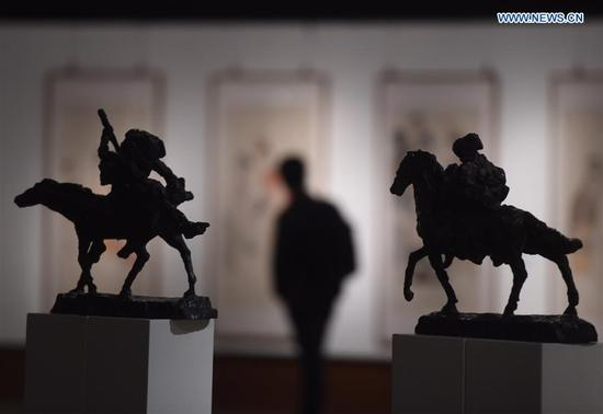Artworks are displayed at the exhibition of New Vision of Chinese Art 2018 in Beijing, capital of China, March 12, 2018. The exhibition, displaying artworks supported by China National Arts Fund, kicked off here on Monday. (Xinhua/Luo Xiaoguang)