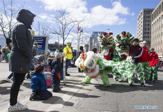 Green lion dance team perform during the 2018 Toronto St. Patrick's Day Parade in Toronto, Canada, March 11, 2018. Thousands of people came out to celebrate the Irish history, culture and heritage by taking part in the 2018 Toronto St. Patrick's Day Parade on Sunday. (Xinhua/Zou Zheng)