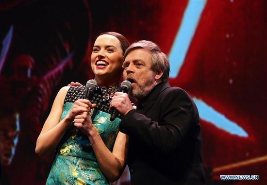 "British actress Daisy Ridley (L) and U.S. actor Mark Hamill greet the audience at the Chinese premiere of ""Star Wars: The Last Jedi"" at the Shanghai Disney Resort in east China's Shanghai, Dec. 20, 2017. The film will be screened in China on Jan. 5, 2018. (Xinhua/Ren Long)"