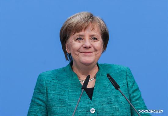 "German Chancellor and leader of German Christian Democratic Union (CDU) Angela Merkel reacts during a joint press conference at the headquaters of CDU in Berlin, capital of Germany, on Feb. 7, 2018. Three German parties reached an agreement on a ""grand coalition"" after tough negotiations, local media reported Wednesday morning.(Xinhua/Shan Yuqi)"