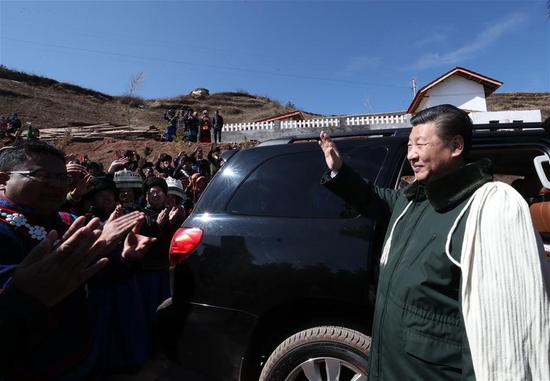 Chinese President Xi Jinping, also general secretary of the Communist Party of China Central Committee, bids farewell to villagers as he visits Huopu Village of Jiefang Township in Zhaojue County of Liangshan Yi Autonomous Prefecture, southwest China's Sichuan Province, Feb. 11, 2018. Xi made an inspection tour in Sichuan Province on Feb. 11. (Xinhua/Xie Huanchi)